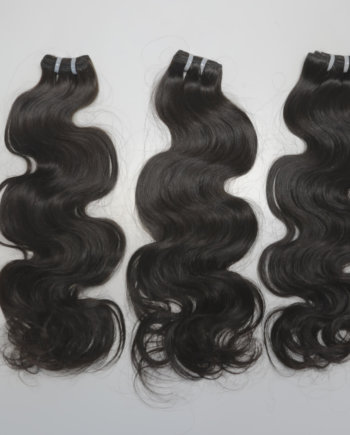 Indian temple hair in a body wave pattern. We add safe steam in order to achieve styles like Brazilian hair, Peruvian hair, and Malaysian hair.