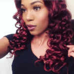Indian temple hair curled and styled into a red deep curly beautiful weave